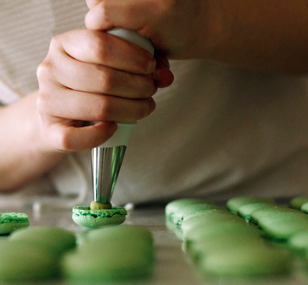 When piping macarons, hold the bag with your dominant hand on the bottom and non dominant on top